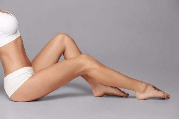 Perfect slim toned young body of the girl